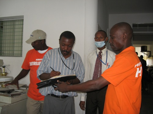 November 25, 2010: Mr. Origen Jean Claude from CTC Cholera Treatment Center, Centre L'OFATMA signing for receiving the donation of 1 barrel of bleach for centre L'OFATMA to help fight cholera in Haiti.