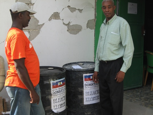November 22, 2010. Mr. Allain Demesier from Haiti Relief Fund and Mr. Zilien Andrice, magasinier of the Hospital L'Universite D'Etat D'Haiti Port-au-Prince Haiti. The Hospital was in need of bleach to help fighting Cholera, and Haiti Relief Fund is looking to bleach Cholera out of Haiti.