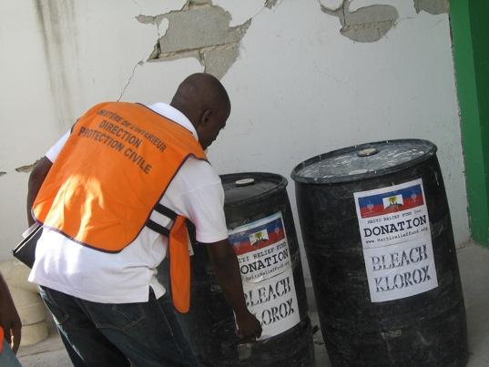 November 22, 2010. Staff members of Haiti Relief Fund's donation. Deliver 2 barrels of bleach to Hospital L'Universite D'Etat D'Haiti Port-au-Prince Haiti. While an inspector from de Ministre De Linterieur Direction Protection Civile.