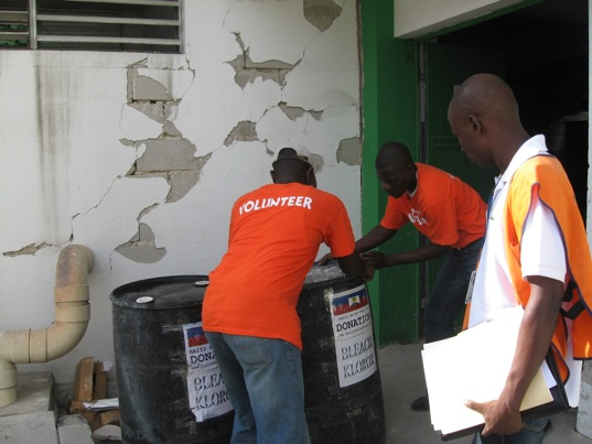 November 22, 2010. Staff members of Haiti Relief Fund's donation. Deliver 2 barrels of bleach to Hospital L'Universite D'Etat D'Haiti Port-au-Prince Haiti. While an inspector from de Ministre De Linterieur Direction Protection Civile.